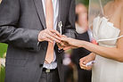photo-of-groom-putting-wedding-ring-on-h