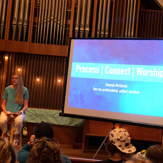 Hannah McGinnis opens the retreat sharing about the heart behind and road to Still Waters during Friday night's session