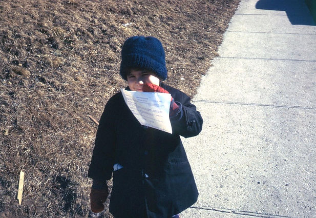 eli with note pinned to mitten.jpg