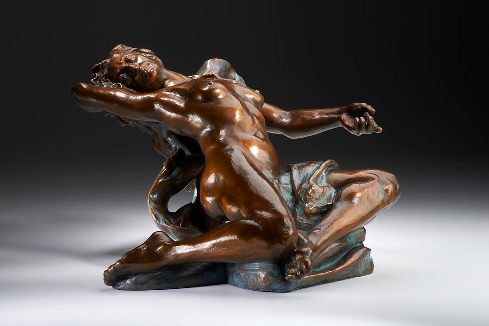 Bronze statue of nude woman representing Sappho