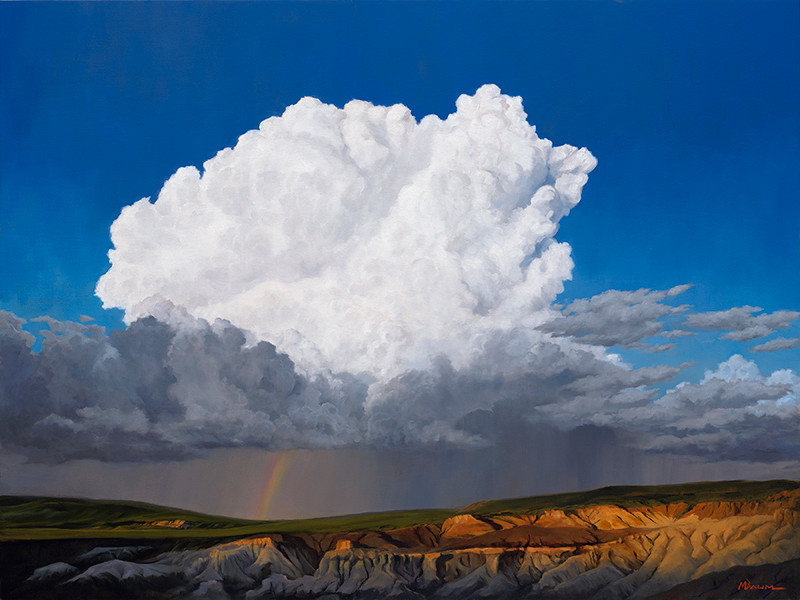 White cumulus cloud over gray rain louds with rainbow and rock formations.