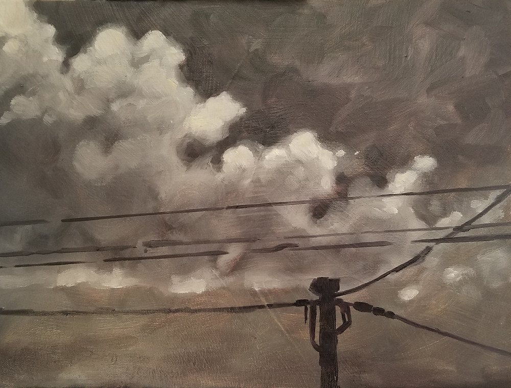 Sepia colored and gray sky with clouds and power lines.