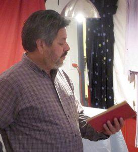 Artist Chris Alvarez reading a book.