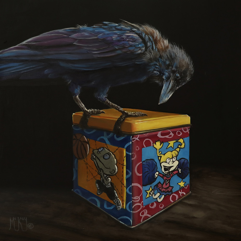 A raven sits atop of colorful child's toybox.