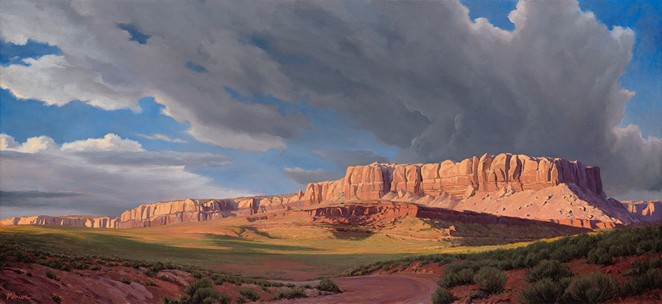 Canyon in southeastern Utah at sunset with storm brewing
