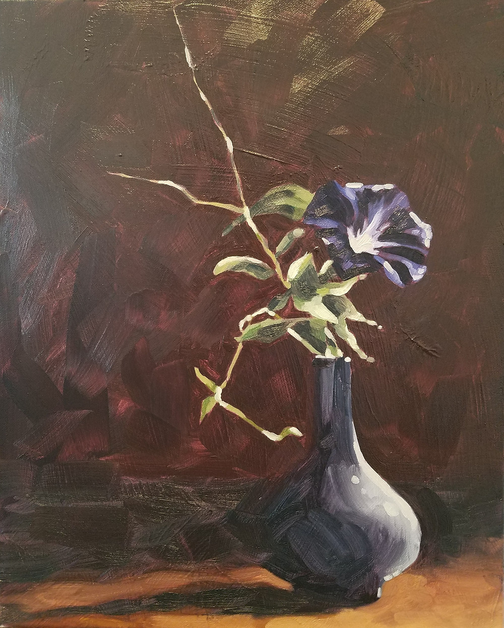 A single purple morning glory in a violet half-lit vase