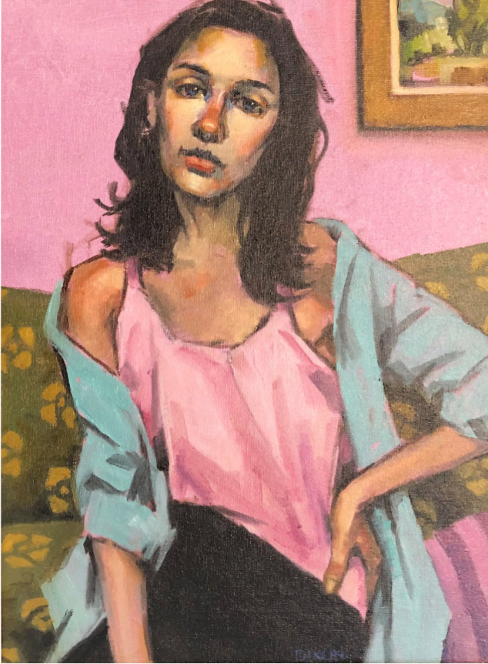 Young woman in a pink room, wearing a pink shirt.