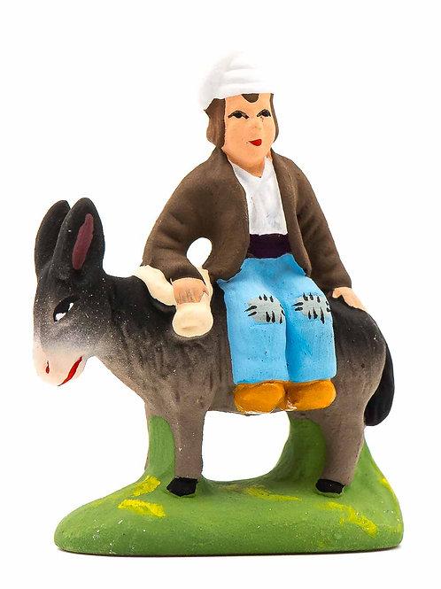Homme sur l'âne Puce