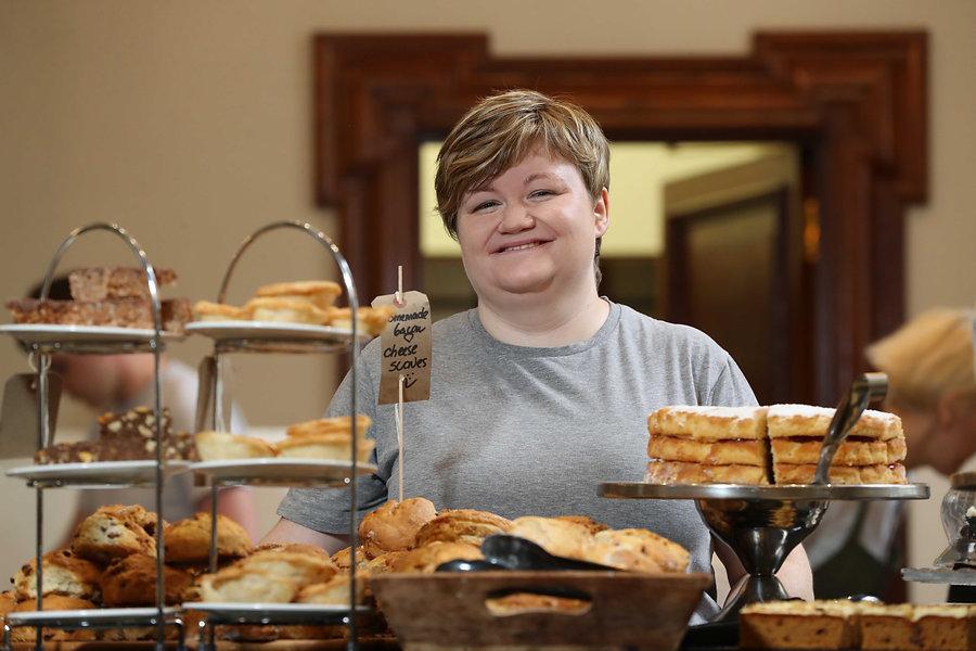 Loaf cafe staff member behind bun counter