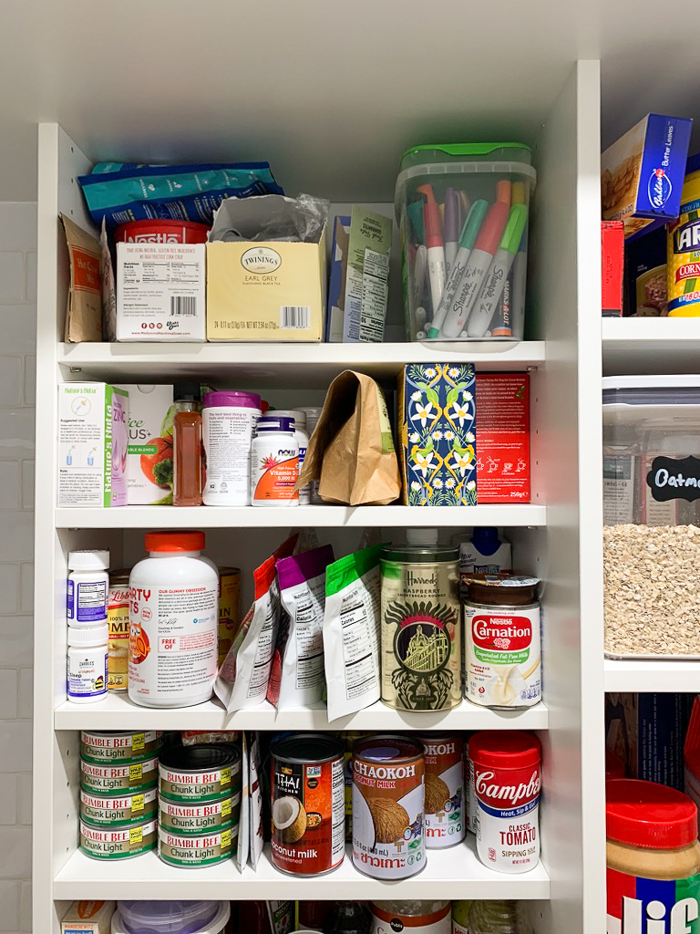 "Adjustable 8"" deep shelves in the Pantry"