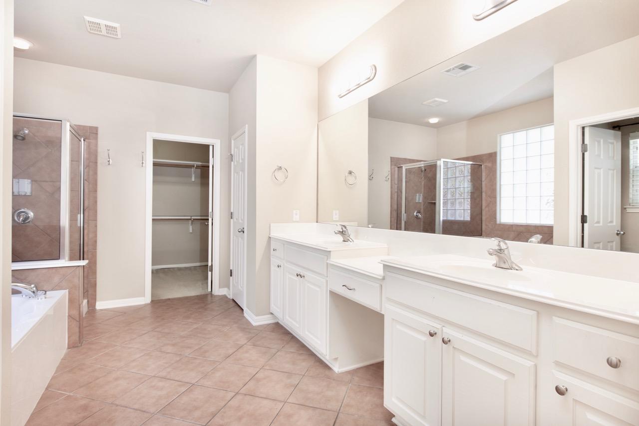 Dual Vanities, Tub, Walk-in Shower