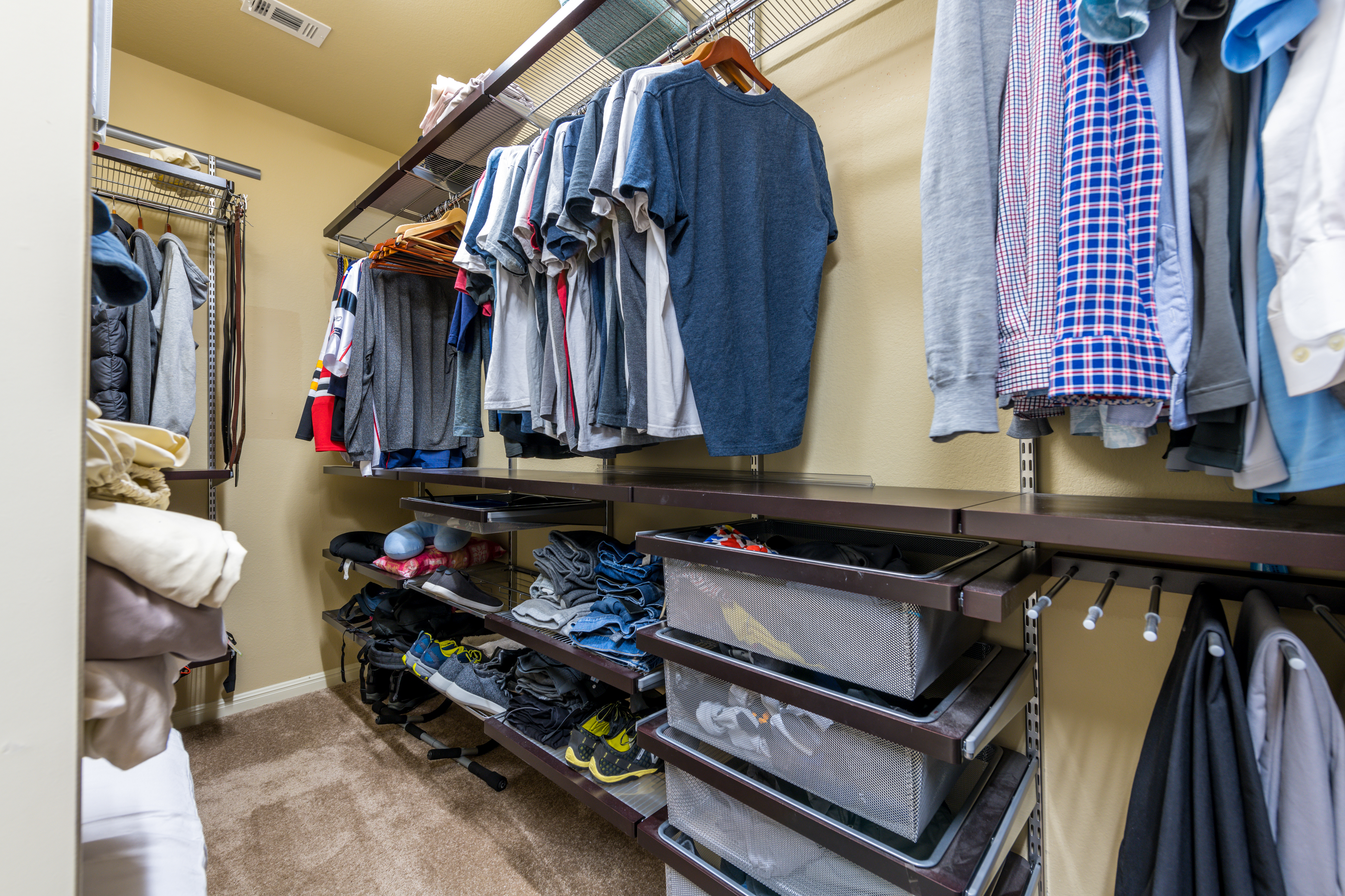 Walk-in Closet with Built in Shelves and Drawers