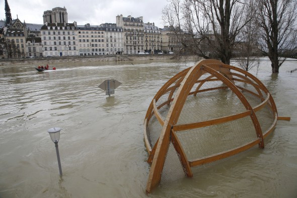 A riverbank playground that's now underwater.