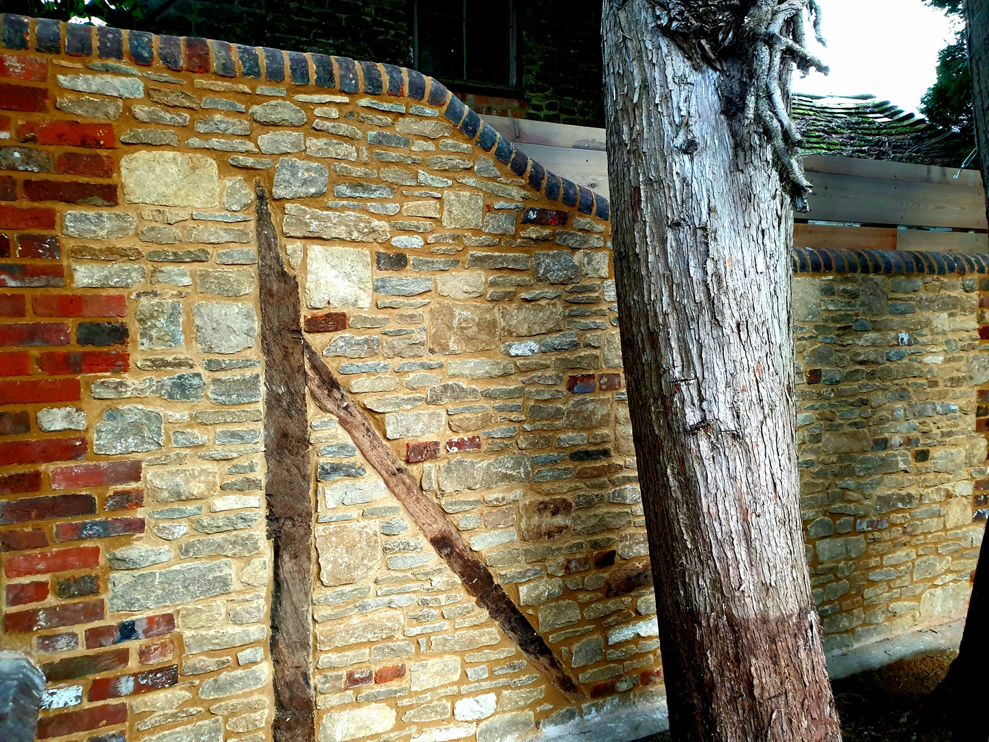 Bargate stone feature wall with reclaimed bricks and oak