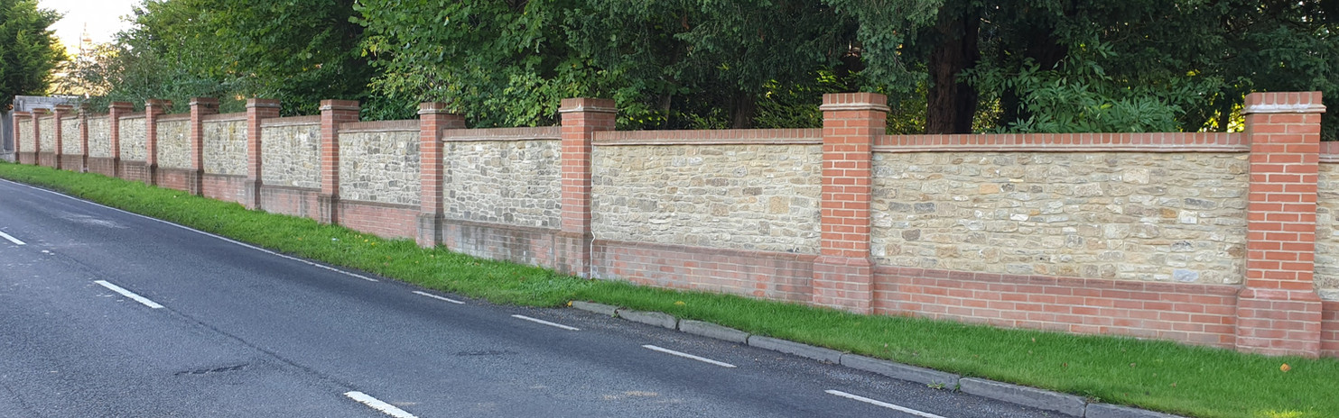 Reclaimed Bargate stone panels with brick piers