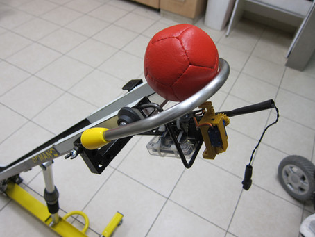 Mechanism to push a Boccia or bowling ball