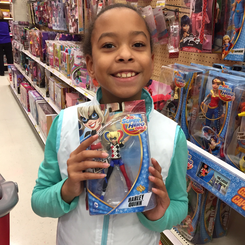 Savanna purchasing gifts for local children in her hometown of South Kansas City.