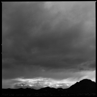 storm looming over Tucson Mountains at dusk