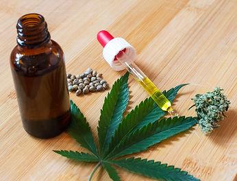 Cannabis oil, seeds and flower placed ar