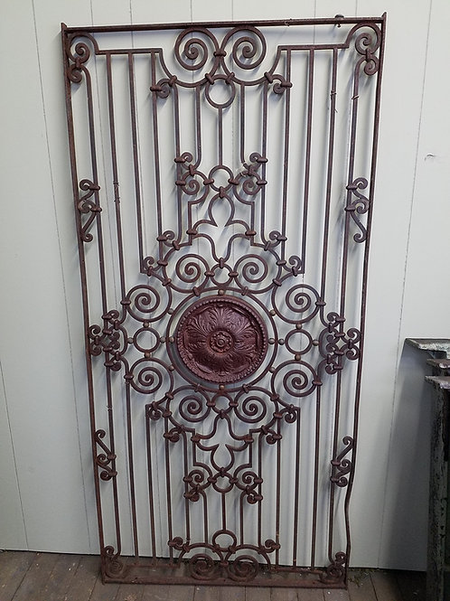 Ornate Antique Iron Gate with Medalion in Center
