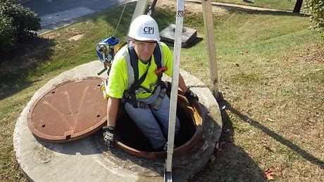 John Spry entering Baysaver - 2 chamber underground unit.jpg