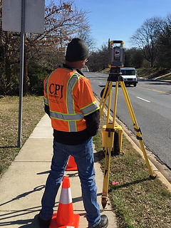 Sam Surveying on Powder Mill.jpg