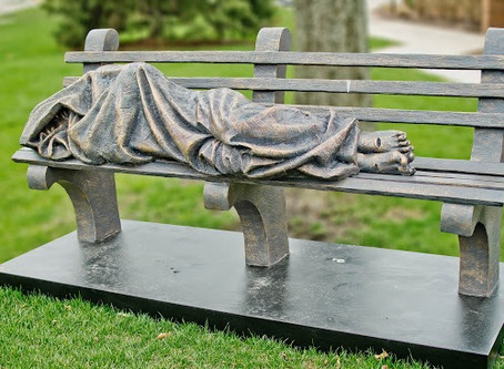 A church put up a statue of homeless Jesus sleeping on a bench and so of course the cops were called