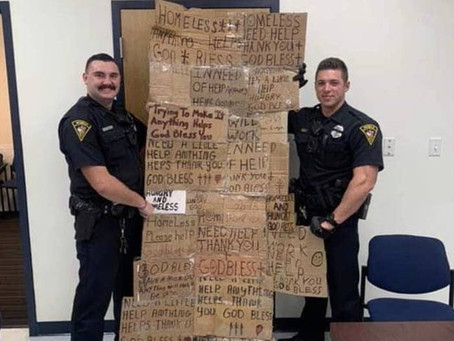 Police Officers used cardboard signs stolen from homeless people as a gag gift for their Supervisor