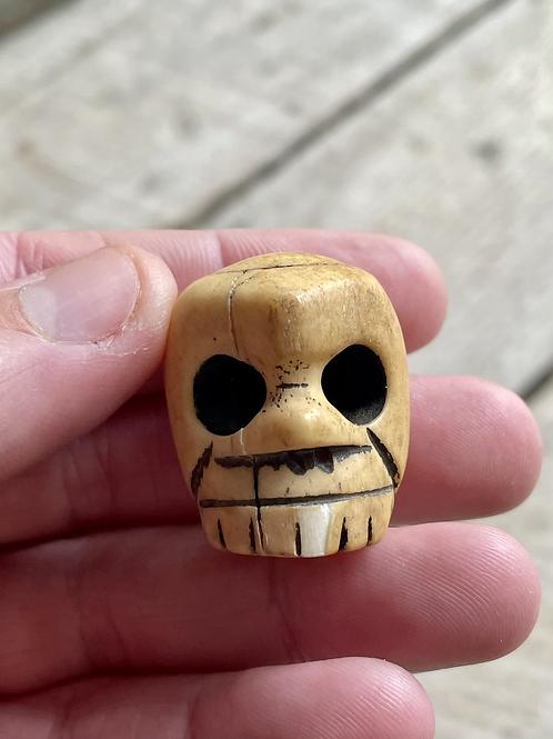Antique large hand carved skull bone bead