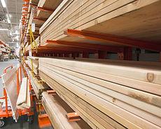 Lumber stacked on shelves
