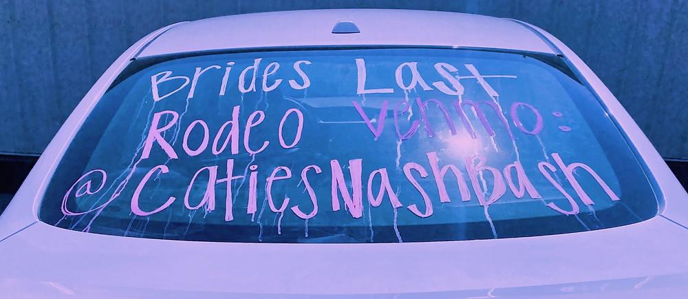 Car window saying brides last rodeo