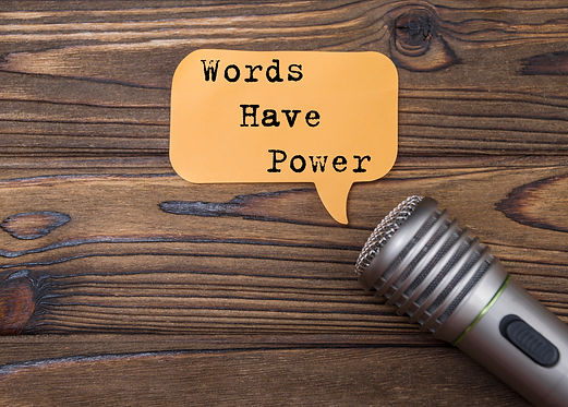 words have power and microphone, on wood
