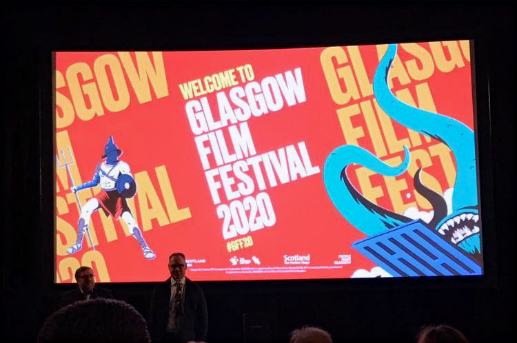 "Allan Hunter (L) looks on as Rob Christopher introduces the World Premiere of ""Roy's World: Barry GIfford's Chicago"" at the Glasgow Film Festival on February 28, 2020"