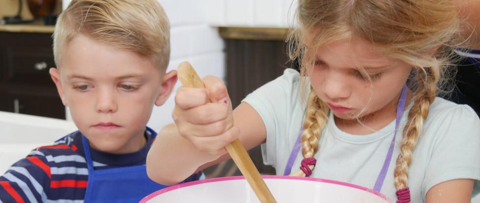 Kids mixing cookies