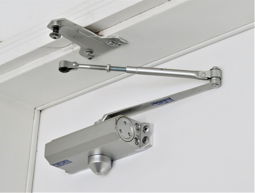 Cardinal & Keys Home Inspections : Garage door closer disconnected