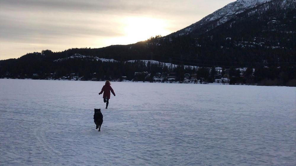 Sunset, Alta Lake, girl running with dog towards mountains