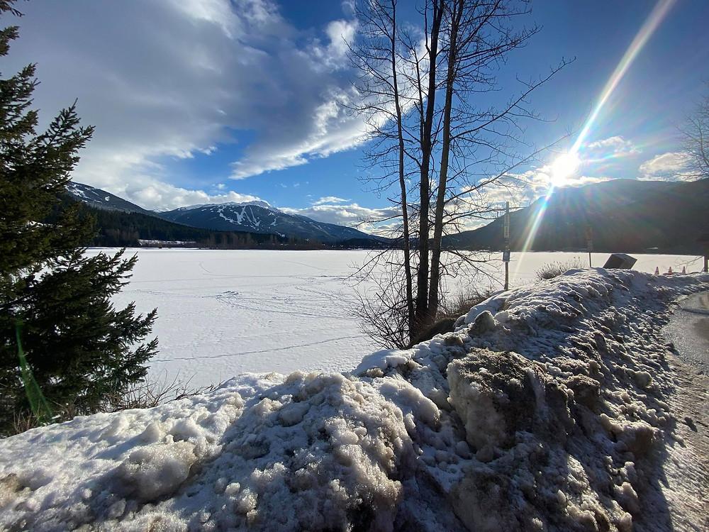 Highway lake lookout, blue skies, snowy, sun shining