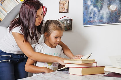 girl-and-mother-reading_23-2147663407.jp