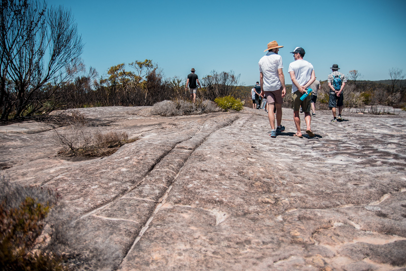 Large rock outcrop home to a series of ancient engraving sites and lying along a traditional song line across the continent of Australia