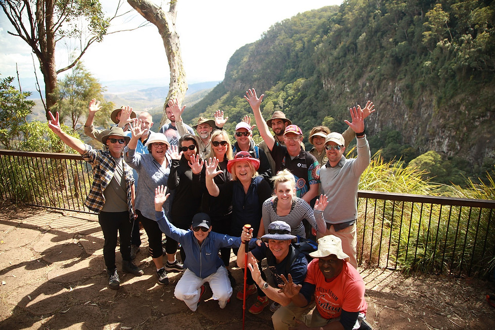 Group enjoying epic views on an adventure together on a multi day retreat in Lamington National Park, Queensland