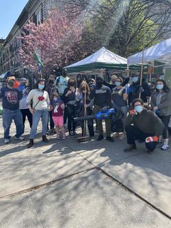 Volunteers gather to clean sidewalks