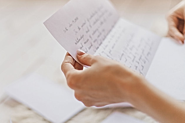 Hands of young woman holding handwritten