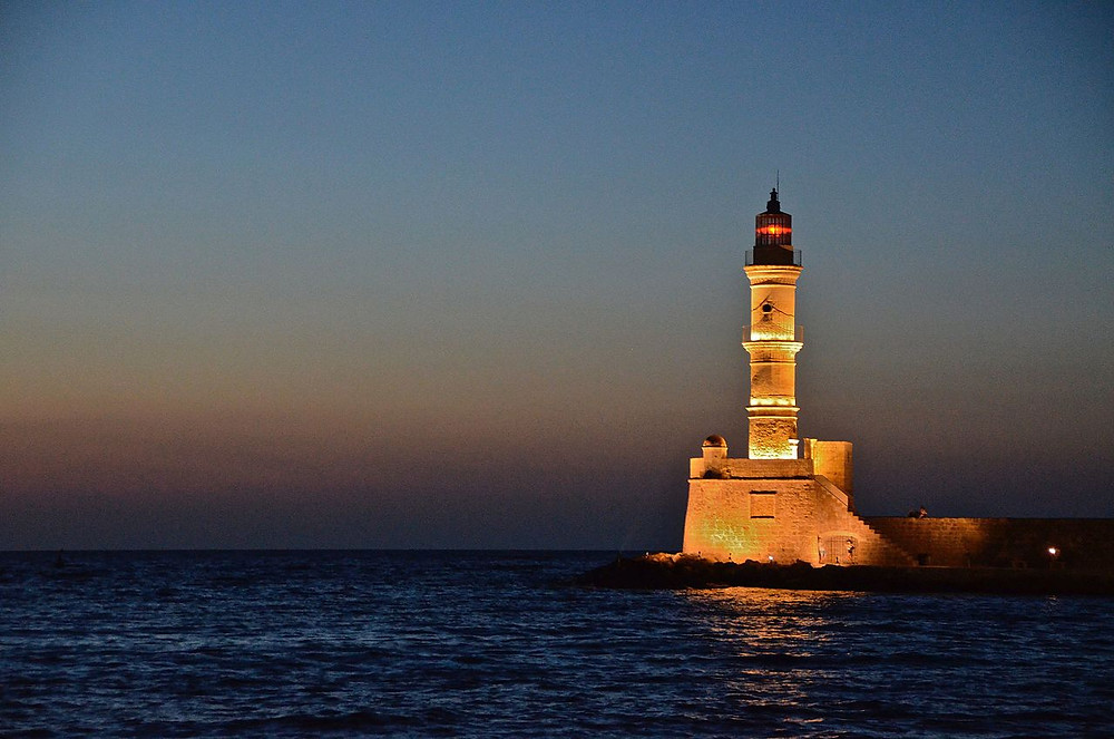 the lighthouse chania old harbor at night