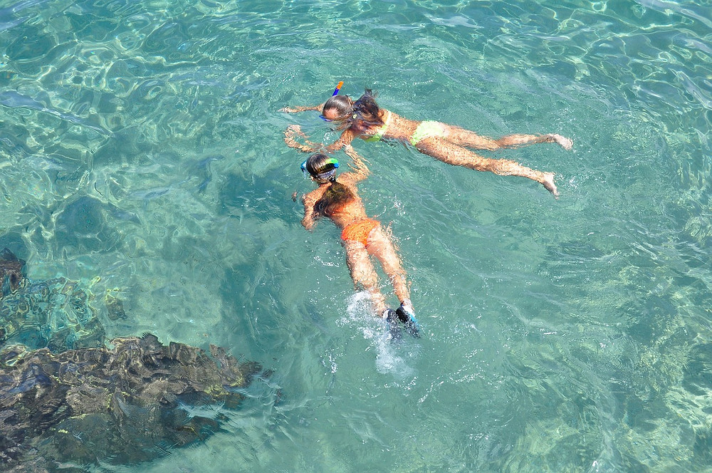 snorkeling in the clear waters of Balos