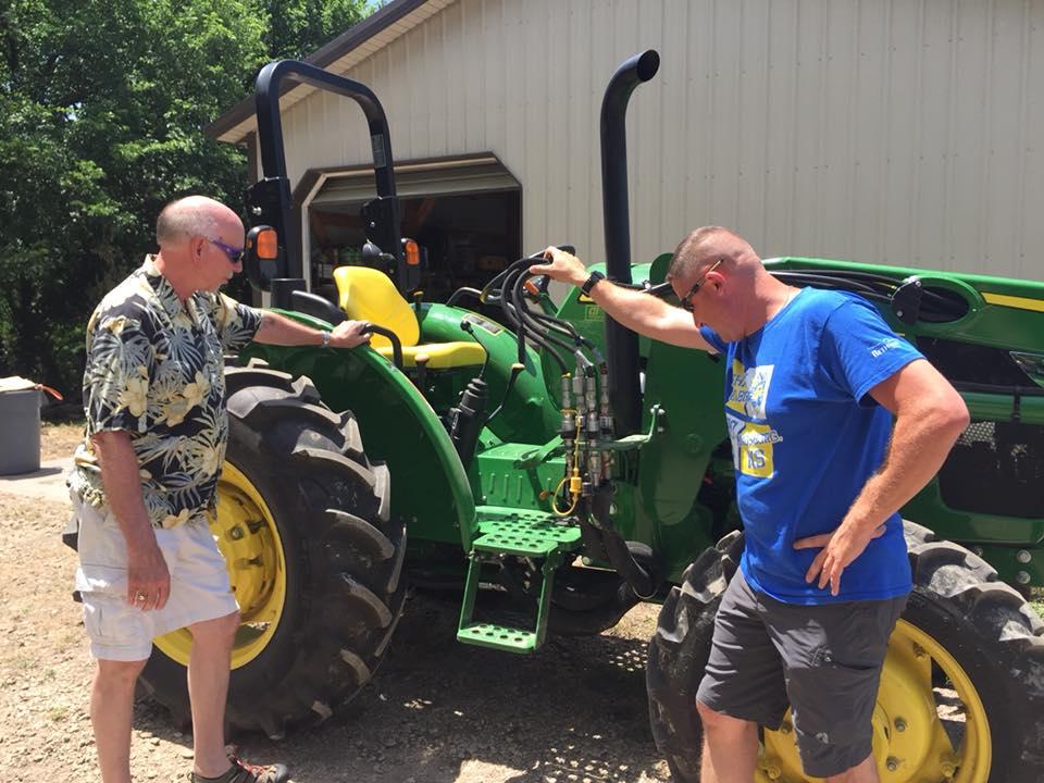 Ben and Roger blessing John Deere