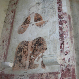 Ancient wall painting of the Holy Trinity.