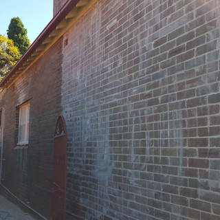 During repointing wall