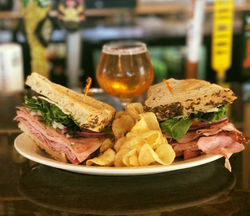 Club sandwich and beer