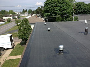 flat slope roofing repairs