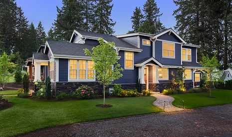 Beautiful Home Exterior at Twilight_ New House with Beautiful Yard and Landscaping with Gl